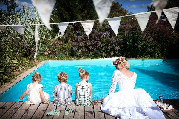 Wedding kids by the pool with the lovely bride. Photo by Lydia Taylor Jones