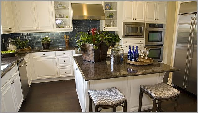 Antiquewhitecabinets in kitchen nara brown caledonia for White kitchen countertops with brown cabinets