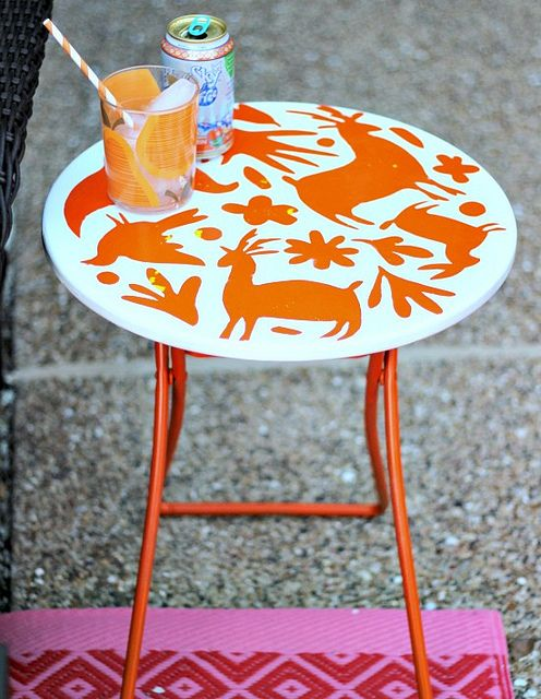 Hi Sugarplum!: {DIY} Otomi Patio Table -- cute spray paint and stencil re-fab idea for a patio table if I can find one at thrift shop