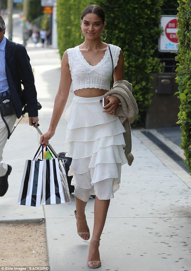 She's all white! Shanina Shaik, 26, flaunted her taut torso in a flirty two-piece ensemble, at reality star Nicole Williams' bridal shower, in West Hollywood on Tuesday