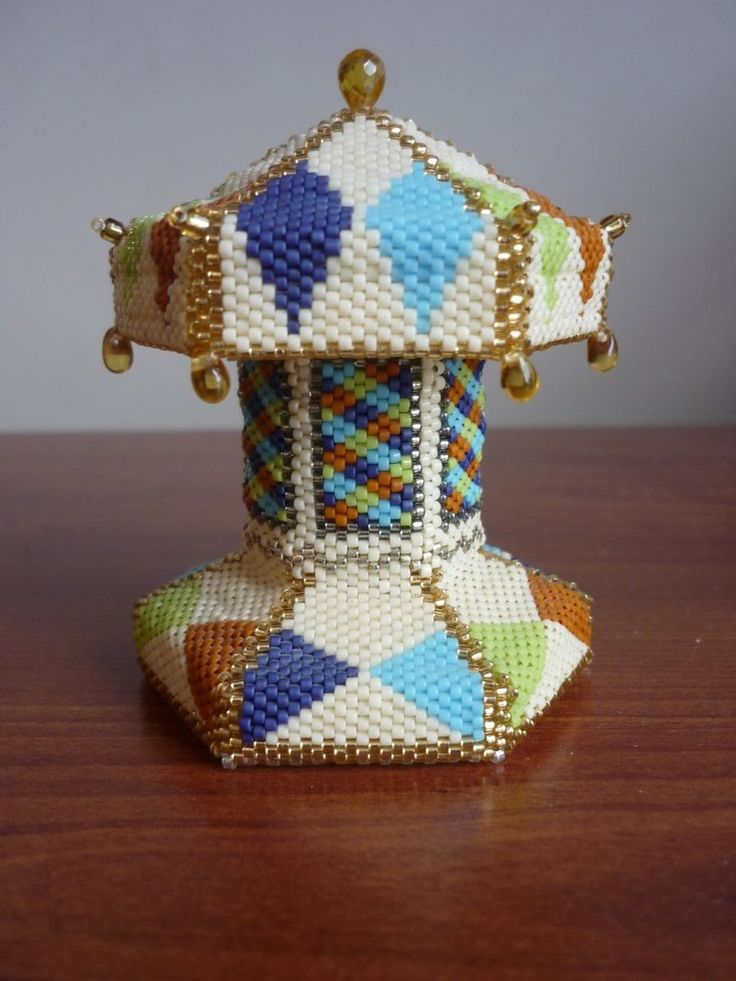 Beaded Carousel, mostly complete. It's been sitting on my pile of unfinished projects for about three years because I haven't been able to find horse/animal beads that I like in the right size. I j...