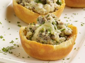 These easy appetizers—made with mushrooms, scallions, cream cheese and Sister Schubert's Dinner Yeast Rolls—will be a huge success at any gathering.