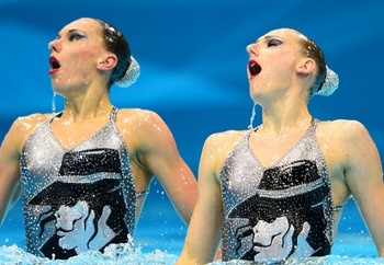 Olympic Russian Synchronized Swimmers' show tribute to the king of pop, Michael Jackson, by having his face emblazoned across their sequined bathing suits.