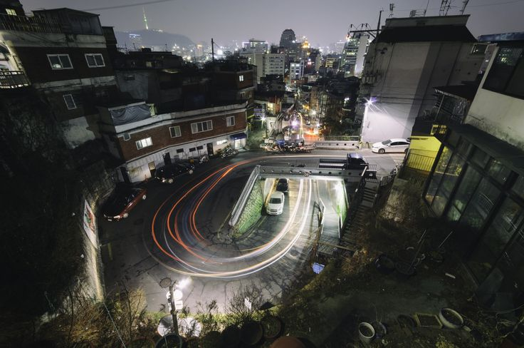 """Light trails at the """"P-shaped road"""" of Ihwa Mural Village. Learn more about Ihwa Mural Village at my new photoblog."""