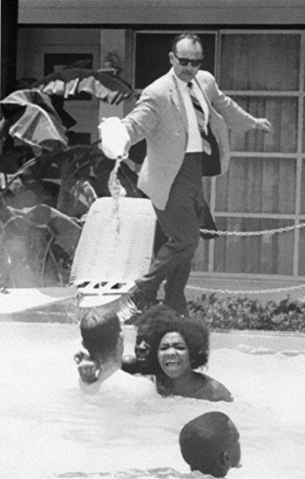 the hotel manager is pouring acid in the pool where black people have jumped