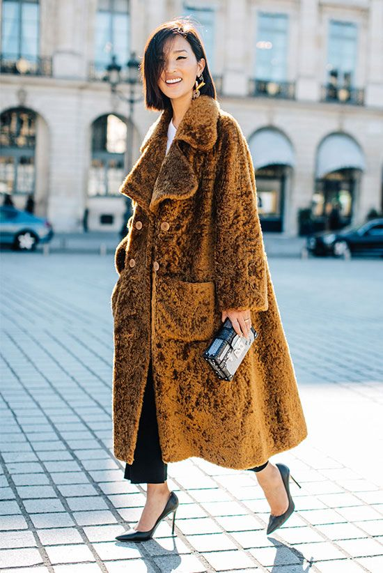 10 Chic Teddy Coat Outfits Worth Recreating: Nicole Warne wearing a brown teddy coat, a white t-shirt, black crop straight pants, black patent heels and a black box clutch. Teddy coat outfit, teddy coat trend, winter fashion, fashion, fashion 2018, fashion trends 2018, street style, office style, office wear, office outfit, work outfit.