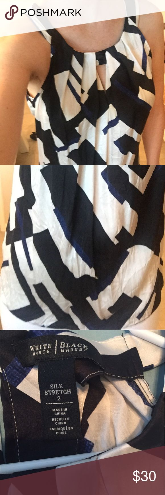 WHBM Silk Sleeveless top White, black, and blue this loose flow fitting top is perfect with jeans or under a blazer for work. It has a eye hole at the top but is not too revealing. I have only worn it twice. Accepting offers. White House Black Market Tops