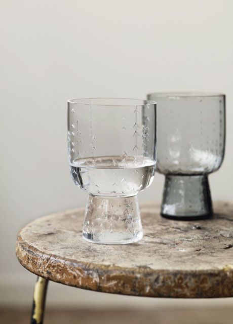 "gorgeous iittala glasses: ""one can eat with hands, but one cannot live without a drinking glass."""