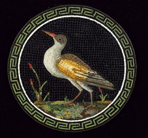 A first half of 19th century Roman micro mosaic circular plaque depicting a wading bird on black background, within an elaborate Greek key border, the plaque mounted on copper, 7.5cm diameter.