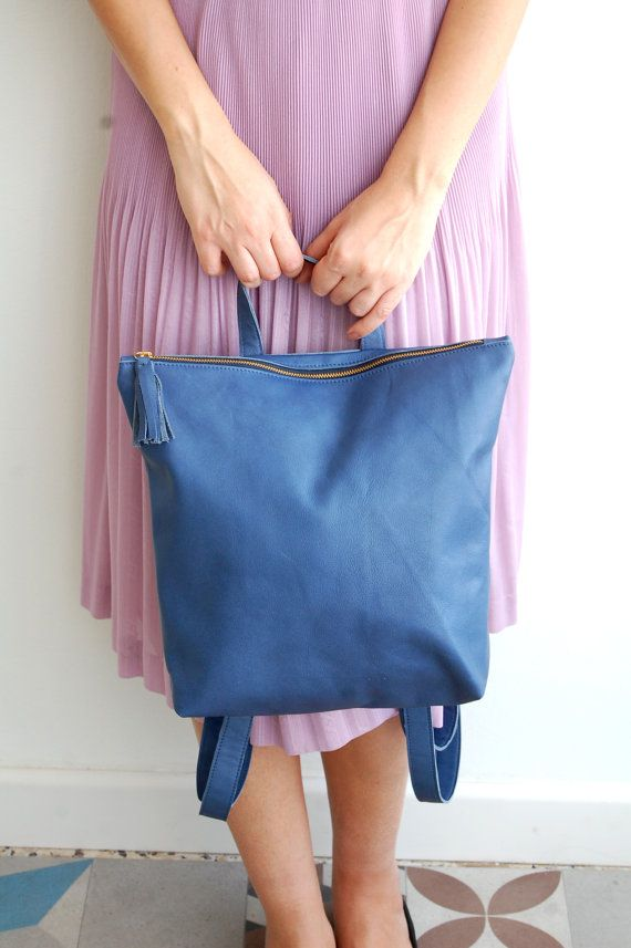 This streamlined leather backpack comes in the loveliest color. #etsy