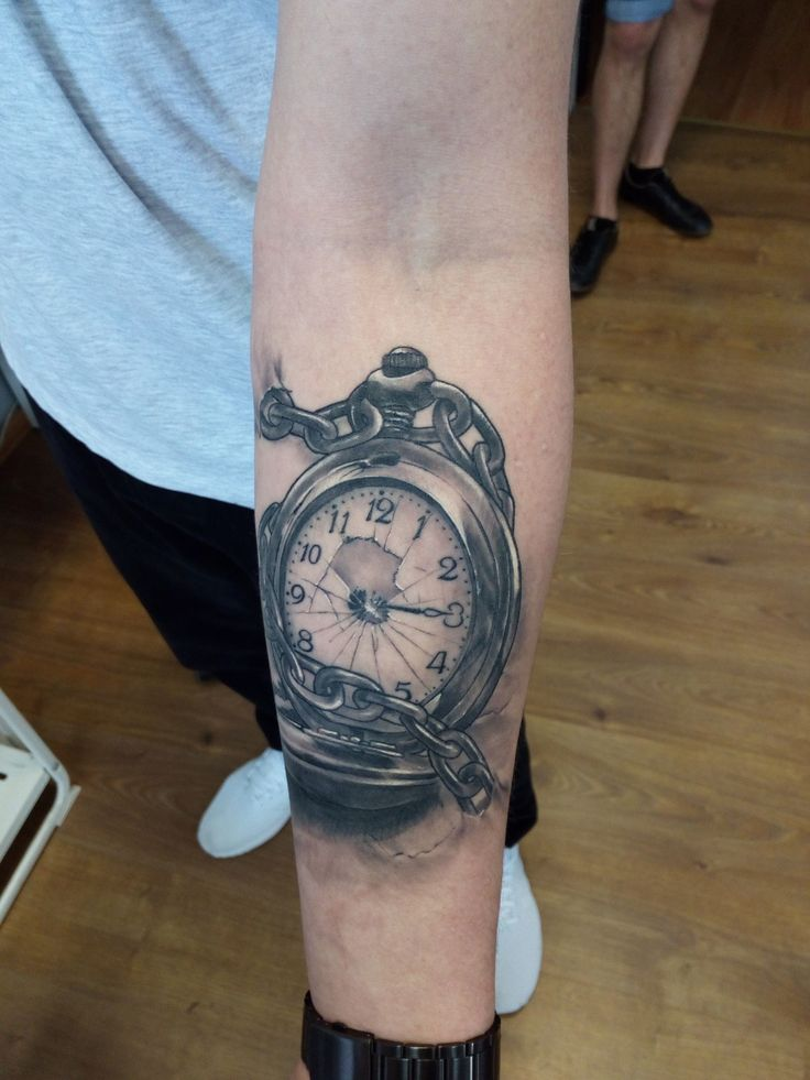 Pocket watch tattoo by Piotr. Limited availability at