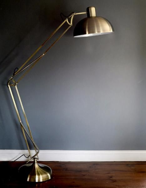 A fantastic floor standing angled lamp in a brushed gold finish. It has a good, sturdy base and so can also just be used as a free standing lamp to add a funky,