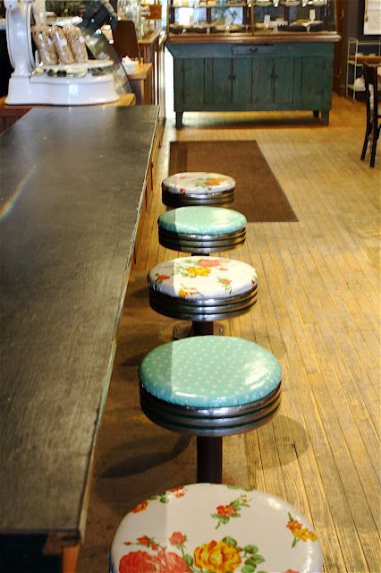 A nice little moment in a bakery/cafe.  How can you not find those stools endearing?
