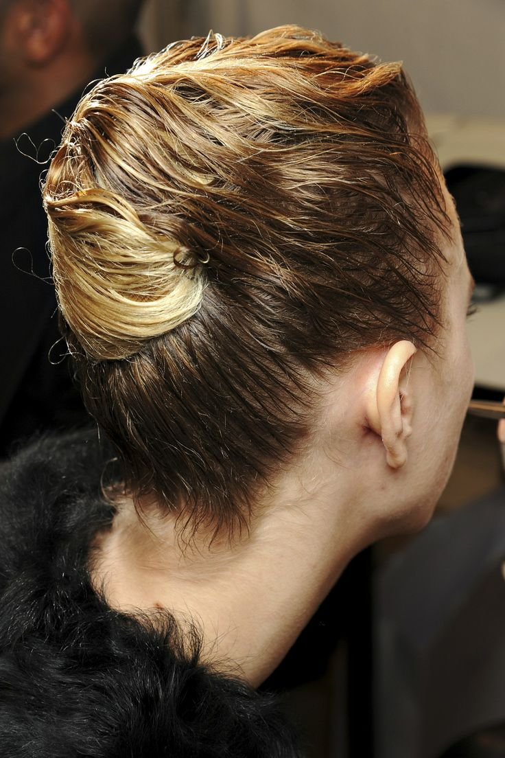 Backstage Hair: Autumn/Winter 2013-14 - Christian Dior: Hair was slicked back from the face in a damp-looking style.