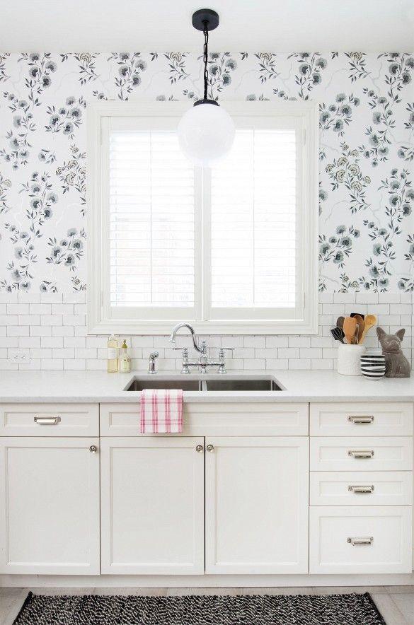 black + white kitchen with globe pendant