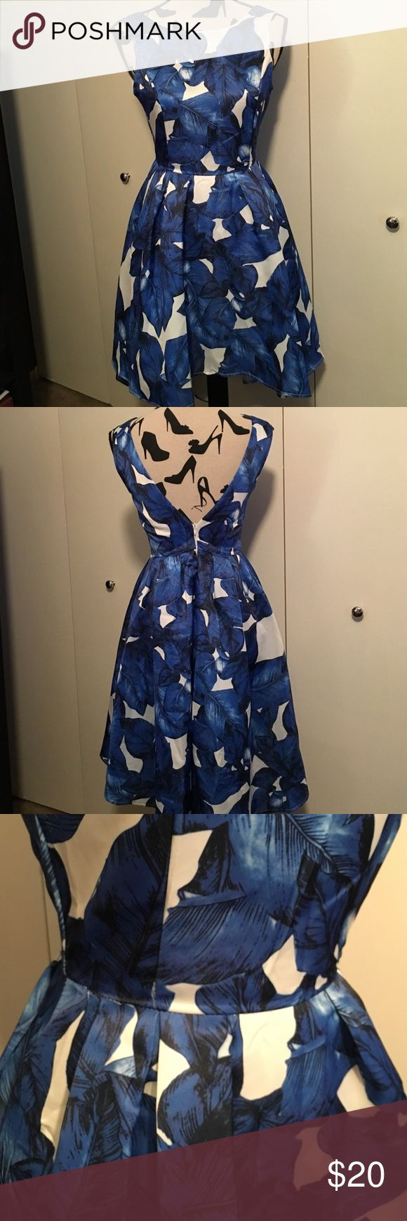 Blue and White Fit & Flare Dress The best wedding guest dress to date. This amazing fit & flare silhouette had a high and low hem.  Comfortable boat neck with v-back. Can be worn with a regular bra! In great condition! Dresses High Low