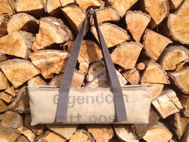 Shoulderbag, made of the old Dutch postbag and grey leather, with 2 zipped pockets inside.
