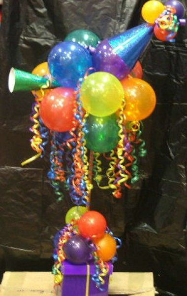 Cute for a World with more Birthdays or with purple/ Relay balloons  great celebration centerpiece idea too!
