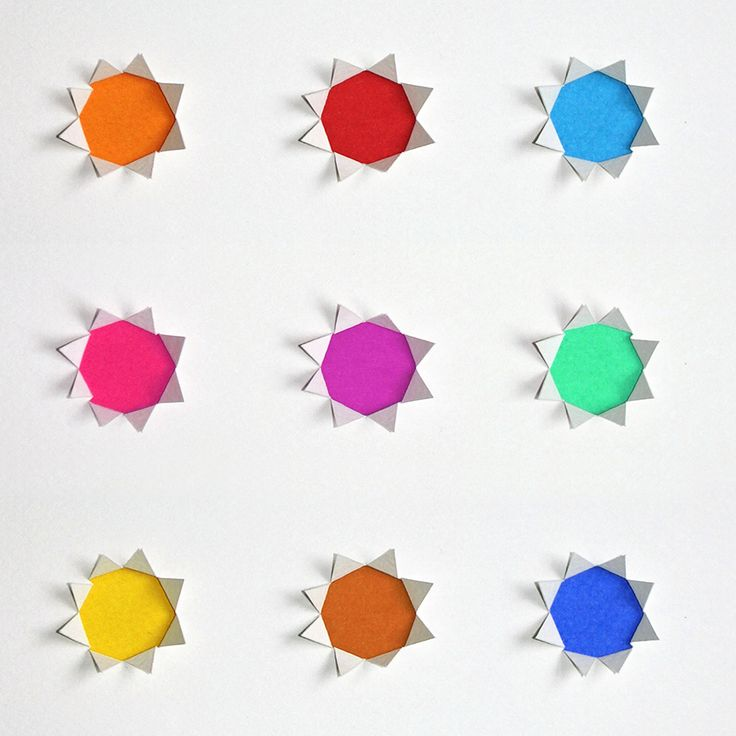 Paper rainbow stars! Cut out and folded #paper #natstatweek #stationery #rainbow #colour
