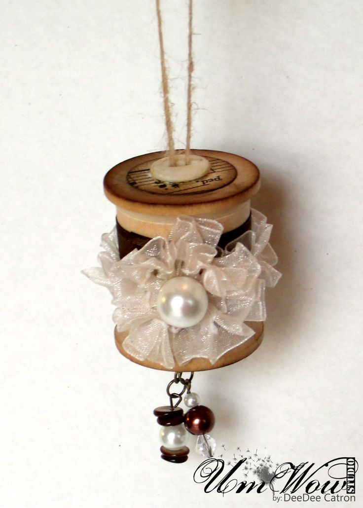 Ornament made from thread spool ...perhaps a certain paper ribbon would be useful here?