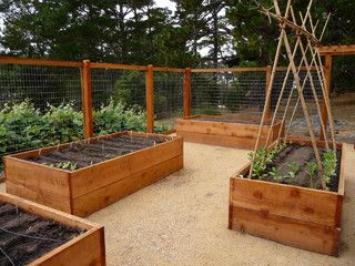 How to Install a Drip Irrigation System. LOVE this wood, fenced in, raised garden area!