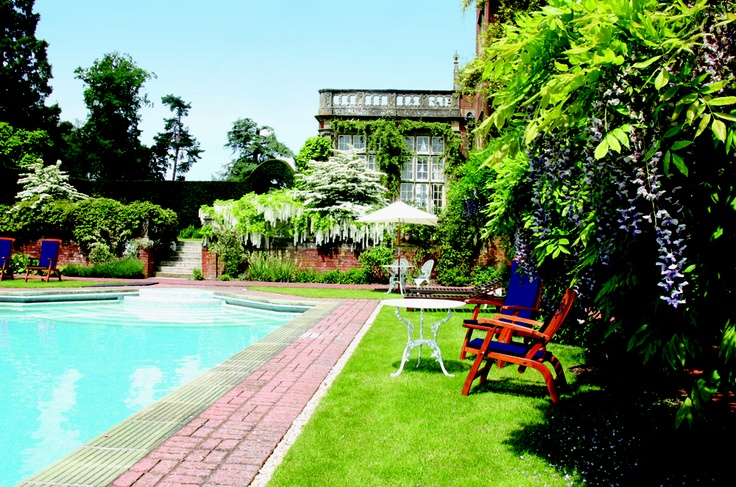 Relax at the outdoor pool at Tylney Hall Spa