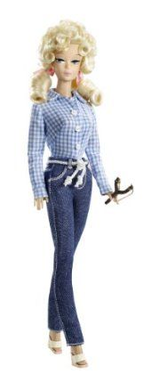 Barbie Collector Beverly Hillbillies Ellie May Doll by Mattel. $32.31. Dressed in her gingham shirt, denim jeans, and espadrilles. A must have addition to your Barbie Collection. Inspired by the classic hit television series, The Beverly Hillbillies. Features her trademark hairstyle with ribbon details. Captures the essence of the classic 60?s TV character portrayed by Donna Douglas. From the Manufacturer                Barbie Collector Beverly Hillbillies Elly May Dol...