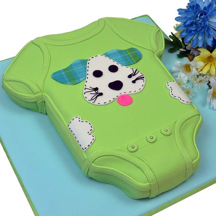 Puppy Dog Onesie Cake tutorial — Their instructions have you using a custom shaped pan, but honestly, it wouldn't be too hard to use a rectangular pan and place the cut pieces from the bottom up top to make the sleeves.