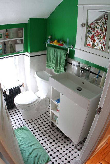 tiny green bathroom with floral shower curtain