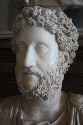 With the death of Roman Emperor Marcus Aurelius in March of 180 CE, the long reign of the five good emperors came to an end and with it so did the Pax Romana (the Roman Peace). Those emperors who followed for the next century would witness a time of both chaos and decline. The first of these inept emperors was Commodus, the son of Marcus Aurelius, who, according to most historians, was not only debauched and corrupt but also a megalomaniac, seeing himself...