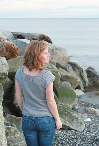 This tee shirt is knit using a cotton linen blend at a loose gauge. The result is an elastic fabric that works up quickly and fits beautifully. The top half of the yoke features a lace panel covering the shoulders and back.