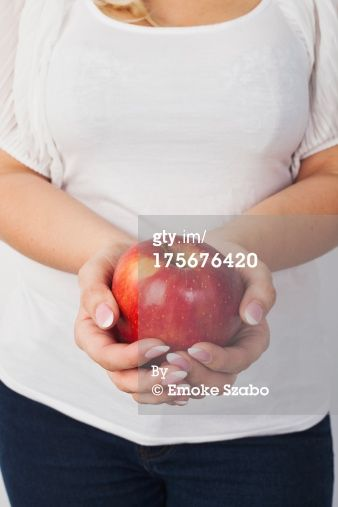 Shiny red apple by Emoke Szabo