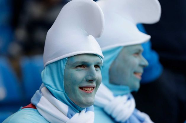 Manchester City supporters in fancy dress take their seats before their team's English Premier League soccer match against Manchester United at The Etihad Stadium, Manchester, England, Monday, April 30, 2012. Photo: Jon Super / AP