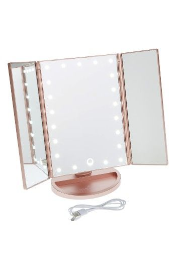 Free shipping and returns on Impressions Vanity Co. Touch 3.0 LED Trifold Makeup Mirror at Nordstrom.com. Take your makeup artistry to another level with this light-up vanity mirror featuring dimmable, energy-saving LEDs and a smart touch sensor—just tap it to turn on, and hold down to adjust brightness. Portable and perfect for travel, the tri-fold design can be positioned multiple ways to catch the best light or do detailed looks, then folds away when you're not glamming up. For added c...