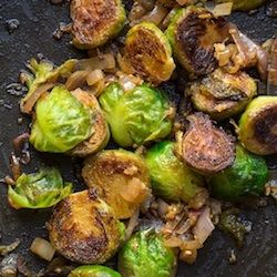 Brussels Sprouts  1 lb brussels sprouts, stems trimmed and outer leaves removed 1 tbsp extra virgin olive oil 1 shallot, thinly sliced 2 cloves garlic, minced 1/4 cup dry white wine Pinch of sea salt and black pepper to taste Cut each sprout in half through the stem. Add sprouts to boiling water and cook until tender-crisp, about 5 minutes. Drain and add to ice bath. Heat olive oil, add sprouts and cook about 5-8 min.Stir in shallots and garlic, cook 1-2 minutes. Add white wine, salt…