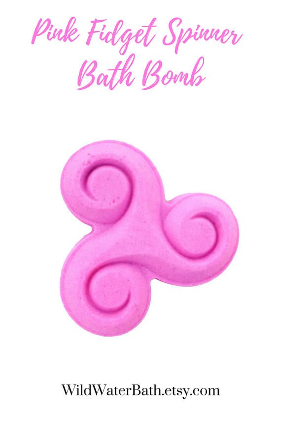 Pink Fidget Spinner Bath Bomb  #Custom #BathBomb   Is pink your favorite color? The you NEED this #fidgetspinner shaped cocoa butter bath bomb. Made with sunflower oil, jojoba and cocoa butter. You pick the fragrance to create a custom bath bomb made just for you.   Turn your bath water into a super moisturizing bath with color! Enjoy a nice relaxing soak with a colorful, fizzy great smelling bath time treat. Just place in full bath tub to release colors, moisturizing butters, oils & scents.