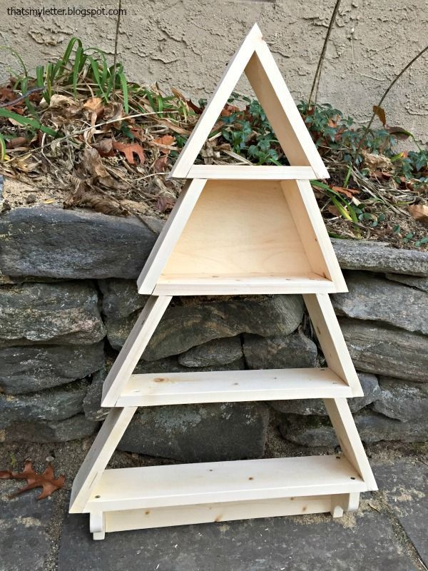 DIY tree shaped shelf.  Free plans to build a tree shelf with hooks.