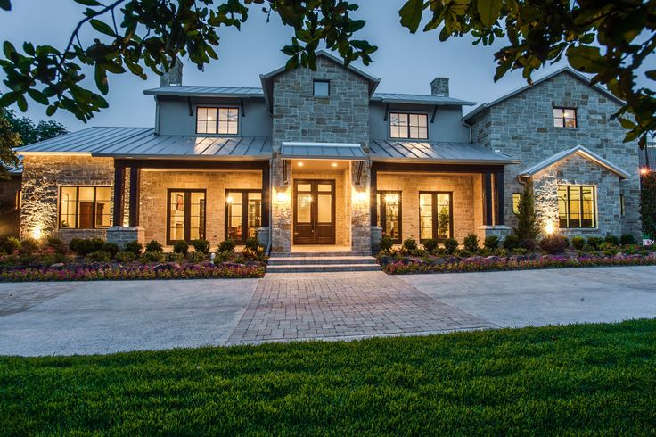 The welcoming look and feel of the Texas Hill Country is an obvious expression of this 9,481 square foot home with its limestone walls and standing seam metal roof plus an additional 1,400 square feet of covered verandas, terraces, and patios that masterfully merge the indoors and the outdoors. Love the pool.