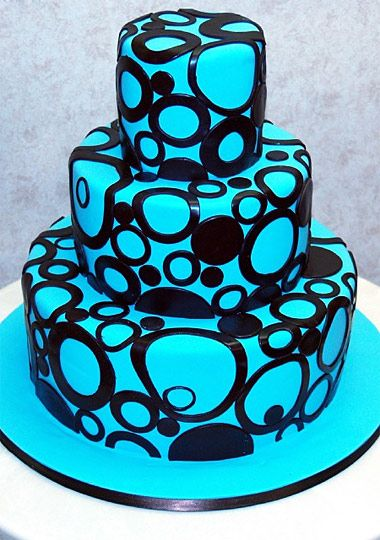 Classic three-tiered cake with a modern design. tlcasia.com #CakeBoss