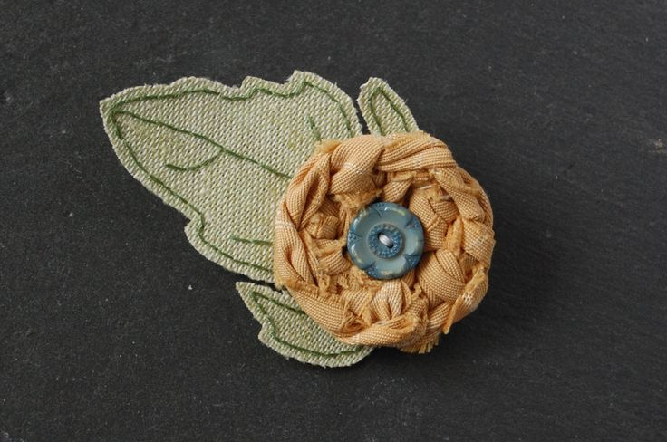 Textile Flower Brooch, featuring knot woven fabric, vintage buttons and hand embroidered leaf - Louise s.a. Allen Everyday Wonders