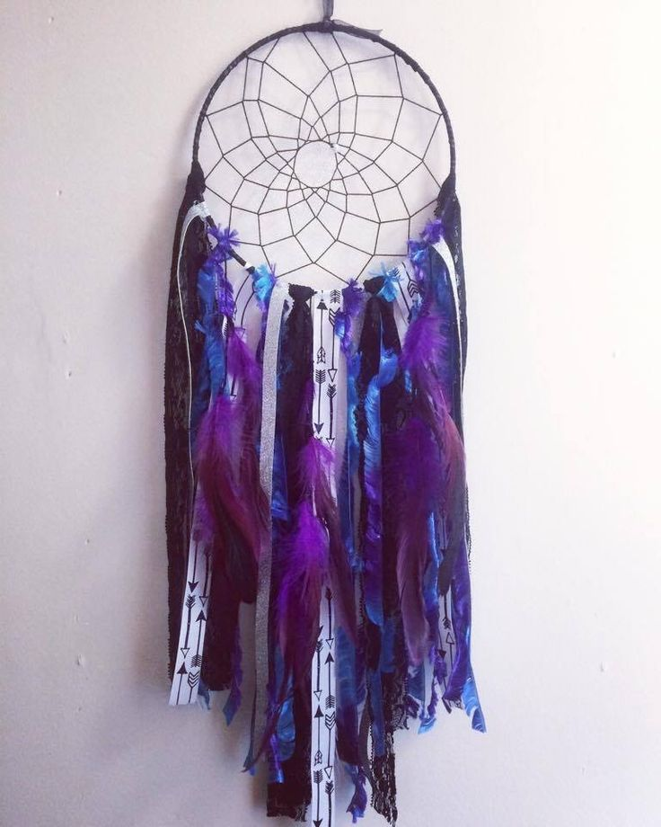 Dream Catcher - Purple. This beauty is purple and black with a hint of blue and contains gorgeous arrow ribbon, lace, and feather detailing. All dream catchers are handcrafted and can be customized with colors of your wish.