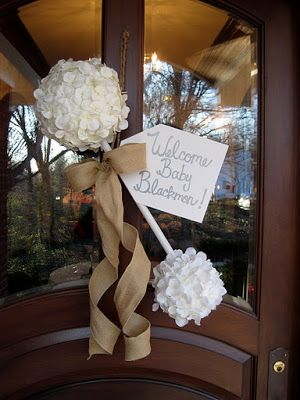 Adorable Baby Rattle with Burlap Ribbon on the front door to welcome guest.