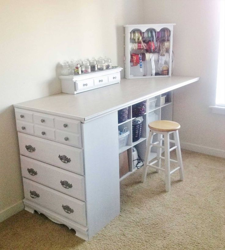 a dresser turned into a table & storage with some plywood & cubby/cube holders