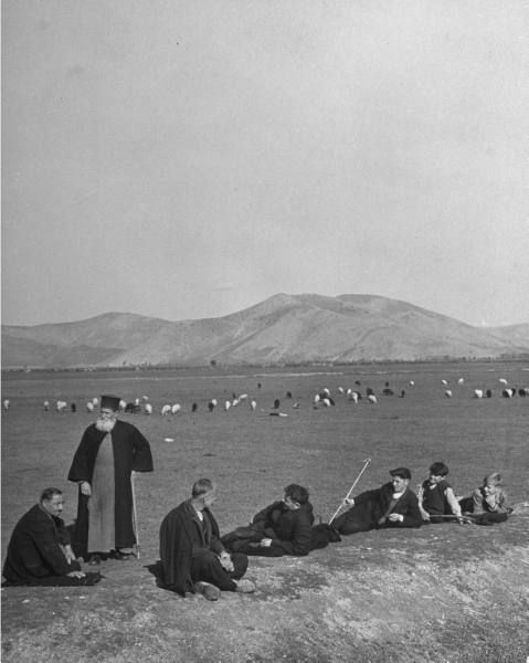 Shepards and priests resting on the country plains.Location:Greece  Date taken:December 1946  Photographer:John Phillips