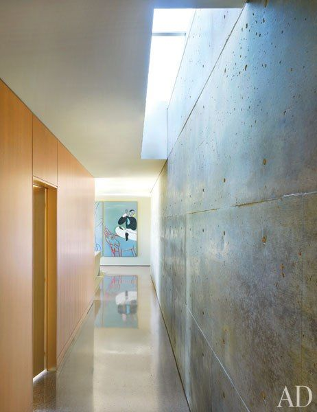 Concrete wall, polished floors and skylight bringing natural light to wash the wall. Lake | Flato Architects and Terry Hunziker
