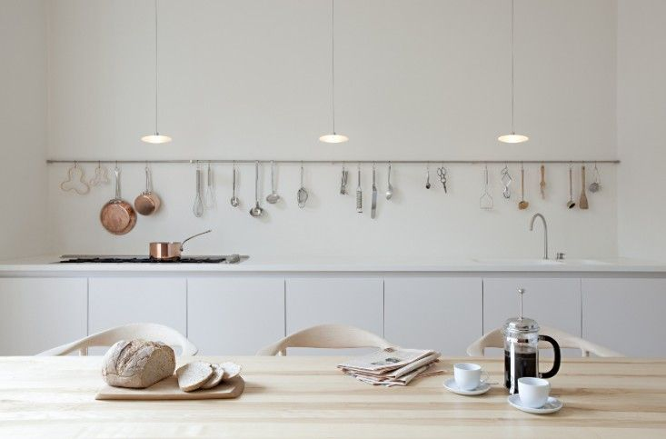 Single hanging rail for storage. Sevil Peach Architects Steels Road London | Remodelista