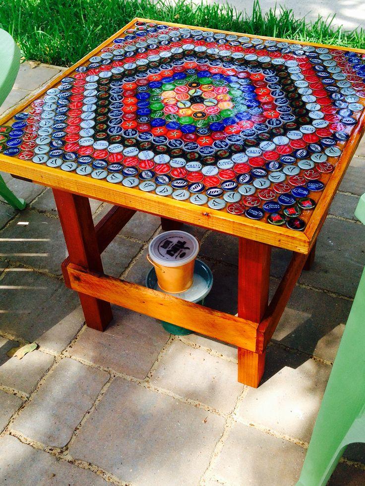 Bottle cap table with cedar frame.