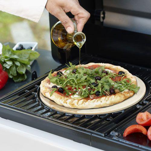 Mozzarella and salad rocket (arugula) pizza