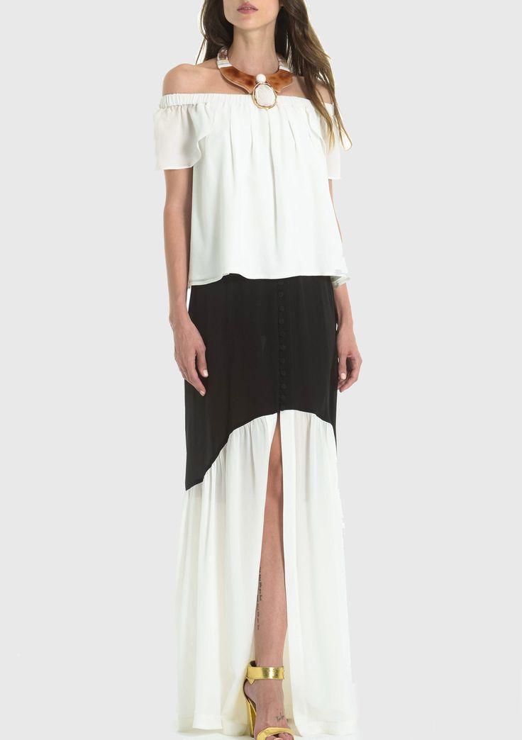 Falda larga de seda con botones a cadera. Composición: 100% silk /seda.
