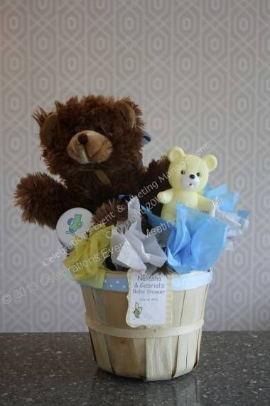 Teddy bear and baby accessories centerpiece. All of the items in the basket are removable for guests when they take them home. Available at Celebrations Event & Meeting Management in Totowa, NJ.